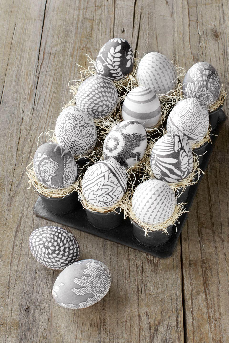 <p>Who knew that silk fabric transfers onto eggshells as easily as the dye in a decorating kit? Regular old vinegar plus hot water does the trick.</p><p><strong>Step 1:</strong> For each egg, cut out a 5-inch square of patterned 100 percent silk. (We limited ourselves to black-and-white prints to achieve the effect above; colored patterns yield more vibrant results.) Lightly dampen the fabric, then lay it flat, right side up, and place your egg in the center. Gather the fabric tightly around the egg, like a beggar's purse, and secure with a rubber band. Repeat this step for the same egg, using a same-size square of plain white cotton and a second rubber band. Note: Use blown eggs if you'd like to keep your handiwork longer.</p><p><strong>Step 2:</strong> Place eggs in a single layer in a nonreactive pot and add enough water to cover them by 2 inches. Add 4 tablespoons of white vinegar. Bring the water to a boil, then reduce heat and simmer for 40 minutes.</p><p><strong>Step 3:</strong> Remove eggs with tongs and cool about 20 minutes. Then unwrap the fabrics to reveal the exquisite designs.</p>