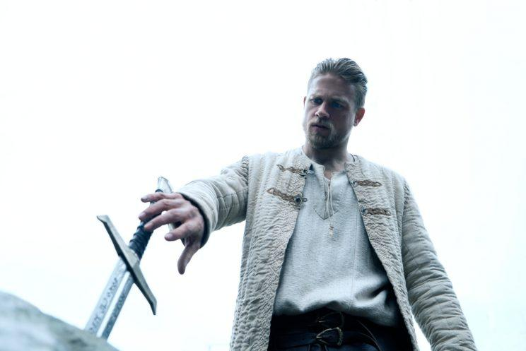 Arthur... the reviews for Guy Ritchie's King Arthur: Legend of the Sword are in... and they're not great - Credit: Warner Bros
