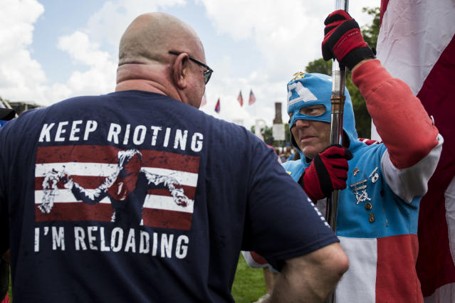 <p>A man dressed as Captain America speaks to a demonstrator during the pro-Trump 'Mother of All Rallies' held on the National Mall in Washington on Sept. 16, 2017. (Photo: Zach Gibson/AFP/Getty Images) </p>