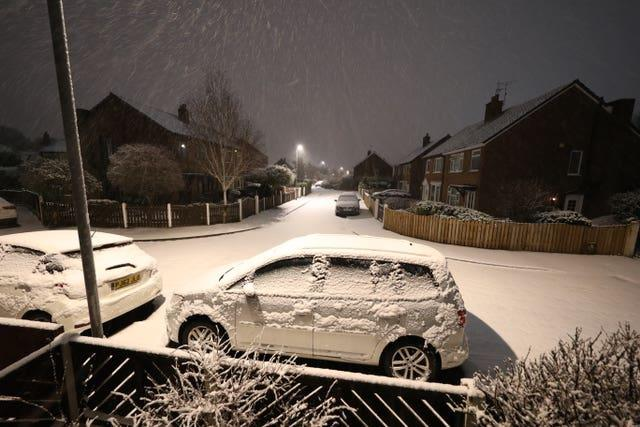 Overnight snow covers cars in Leeds