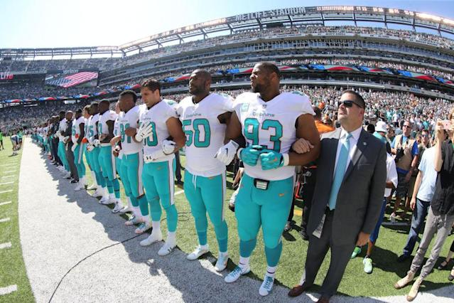 Miami players stand during the anthem. (Getty)