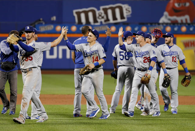 The Los Angeles Dodgers celebrate after defeating the New York Mets in a baseball game, Saturday, June 23, 2018, in New York. (AP Photo/Julie Jacobson)
