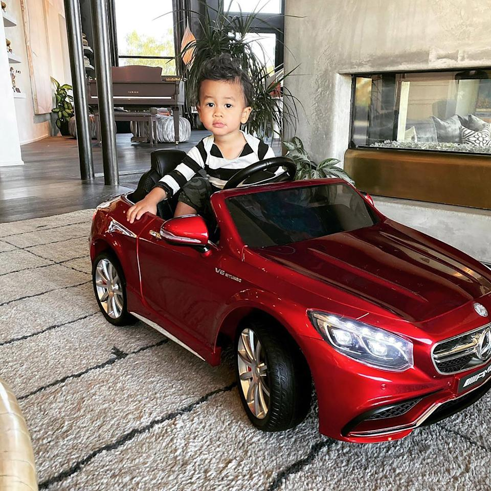 Chrissy Teigen and John Legend make sure that Miles, who turns 2 in May 2020, is riding in style in his red Mercedes-Benz.