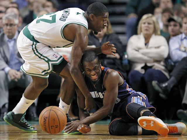 Boston Celtics shooting guard Jordan Crawford, left, and Charlotte Bobcats point guard Kemba Walker, below, scramble for a loose ball in the first quarter of an NBA basketball game in Boston, Wednesday, Nov. 13, 2013. (AP Photo/Elise Amendola)