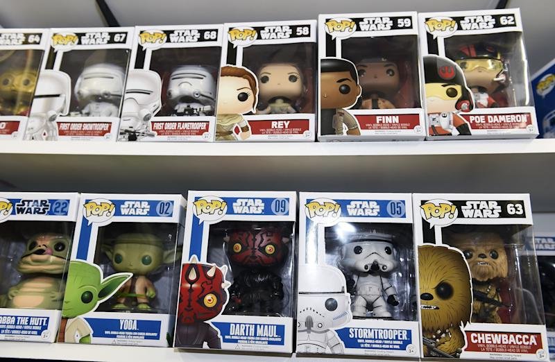 "TO GO WITH AFP STORY BY JOCELYN ZABLIT, ""The Merch Awakens: 'Star Wars' blitz before film opens"" Funko Pop Star Wars action figures line the shelves at Meltdown Comics and Collectibles in Los Angeles on October 30, 2015. From action figures, to boxer shorts, pasta, duct tape and pet outfits, Disney is pulling out all the stops before the release of the new Star Wars movie with a massive merchandising blitz expected to reap billions. The push to drive up excitement for the film began in earnest in September -- nearly four months before ""Star Wars: Episode VII - The Force Awakens"" hits screens -- and has been mounting since, with ecstatic fans around the globe snapping up advance tickets along with products related to the film's beloved characters. AFP PHOTO / ROBYN BECK (Photo credit should read ROBYN BECK/AFP/Getty Images)"