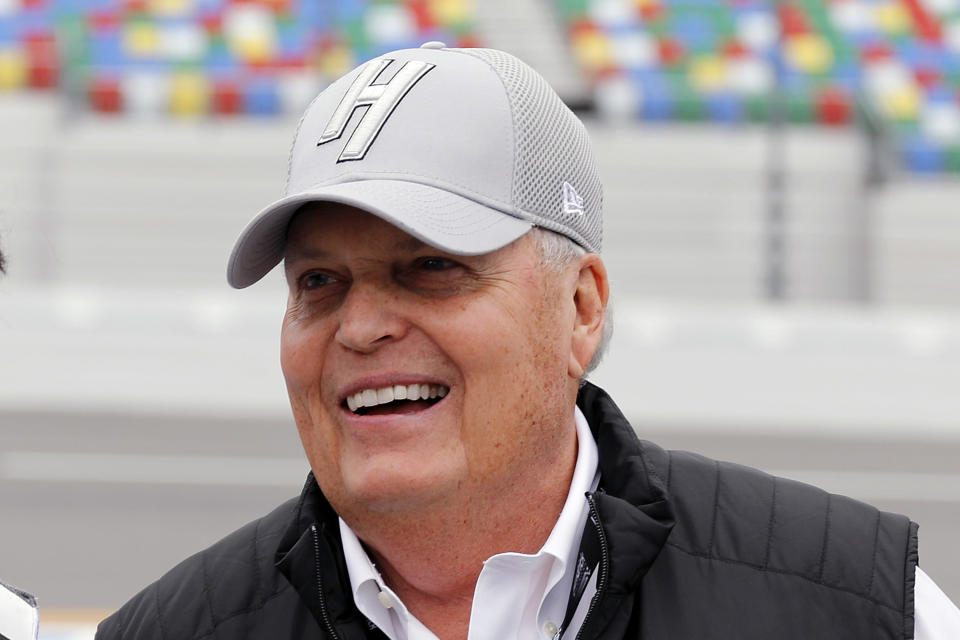 FILE - In this Feb. 10, 2019, file photo, team owner Rick Hendrick laughs on pit road during qualifying for the Daytona 500 auto race at Daytona International Speedway, in Daytona Beach, Fla. Kyle Larson was banished from NASCAR for all but the first month of his last season, his punishment for using a racial slur while racing online. Rick Hendrick felt the driver paid his penalty and deserved a second chance, one that begins with the season-opening Daytona 500. (AP Photo/Terry Renna, File)