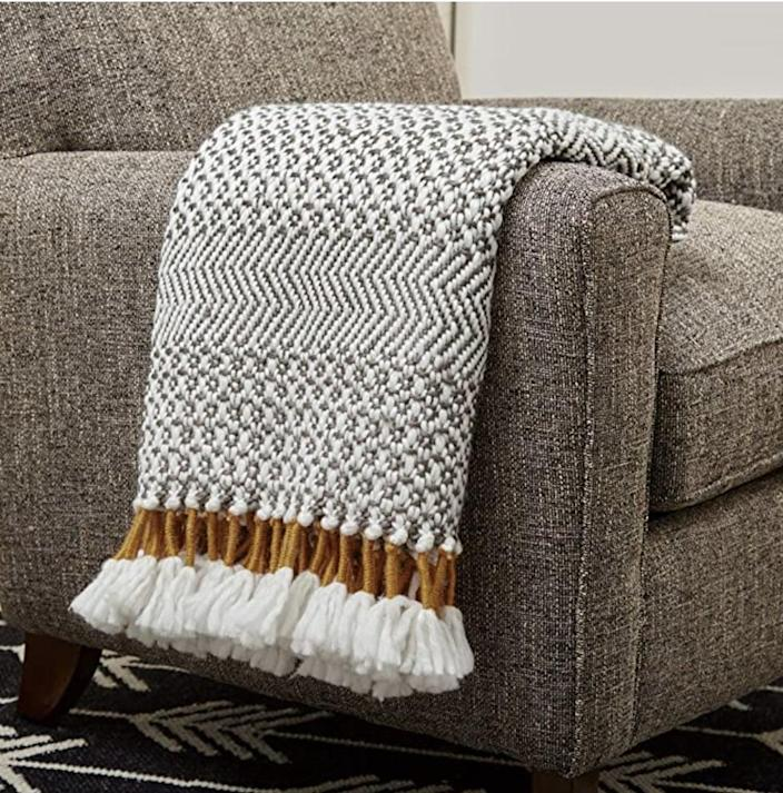 <p>This <span>Rivet Modern Hand-Woven Stripe Fringe Throw Blanket</span> ($50) will keep you cozy all day, every day.</p>
