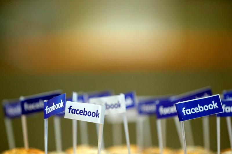 Miniature Facebook banners are seen on snacks prepared for the visit by Facebook's Chief Operating Officer in Paris