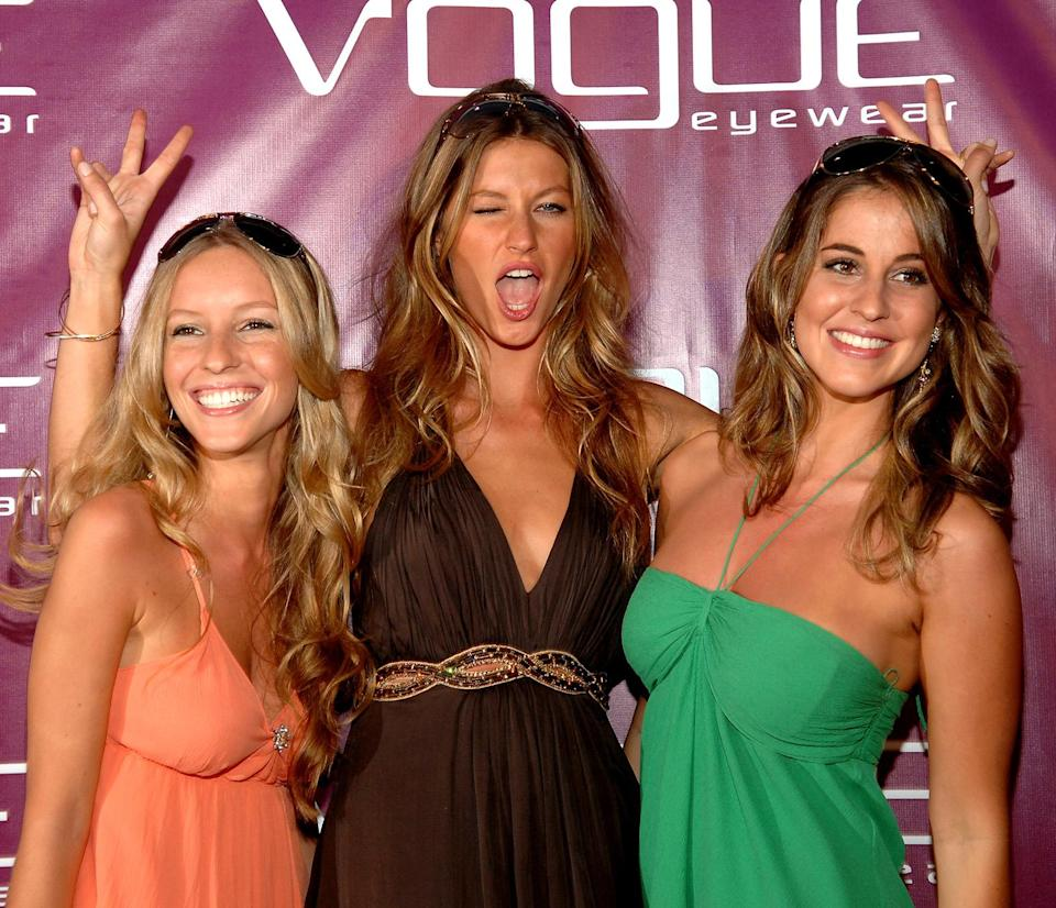 <p>The peace signs seem to be one thing Gisele's sisters didn't pick up from her. (Photo: Getty Images) </p>