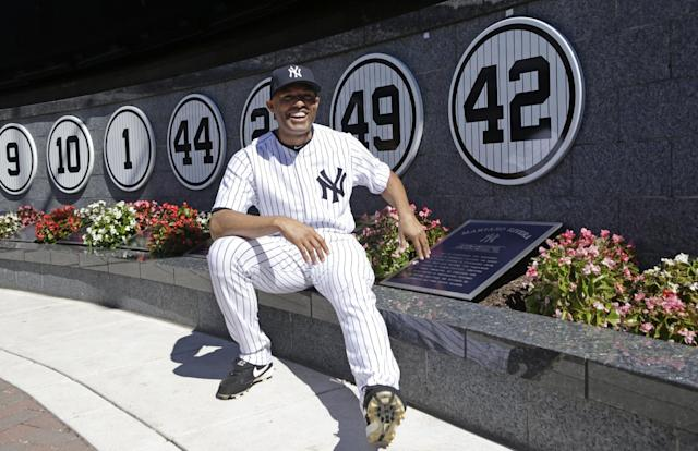 New York Yankees relief pitcher Mariano Rivera (42) poses with a plaque showing his retired number in Monument Park during a pregame ceremony at Yankees Stadium before abaseball game against the San Francisco Giants, Sunday, Sept. 22, 2013, in New York. The 13-time All-Star closer is retiring at the end of this season. (AP Photo/Kathy Willens, Pool)