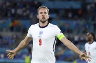 England's Harry Kane celebrates after scoring his side's third goal during the Euro 2020 soccer championship quarterfinal match between Ukraine and England at the Olympic stadium in Rome, Saturday, July 3, 2021. (AP Photo/Ettore Ferrari, Pool)