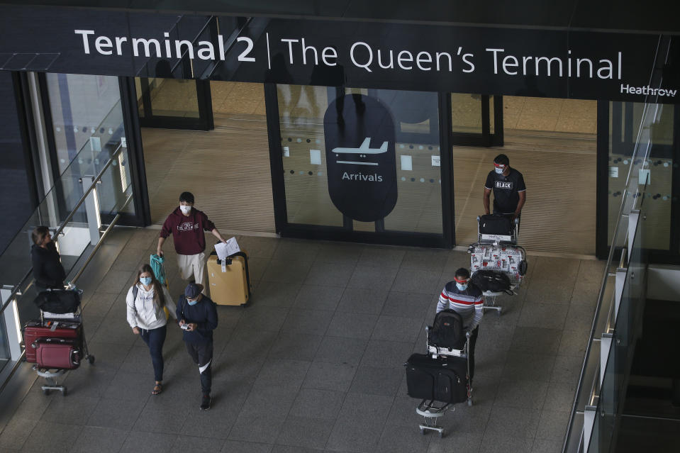 LONDON, ENGLAND - AUGUST 22: Travellers exit Heathrow Airport Terminal 2 on August 22, 2020 in London, England. As of Saturday morning at 4am, travellers arriving in England from Austria, Croatia, and Trinidad and Tobago were required to quarantine themselves for 14 days. At the same time, travellers from Portugal were no longer required to quarantine. (Photo by Hollie Adams/Getty Images)