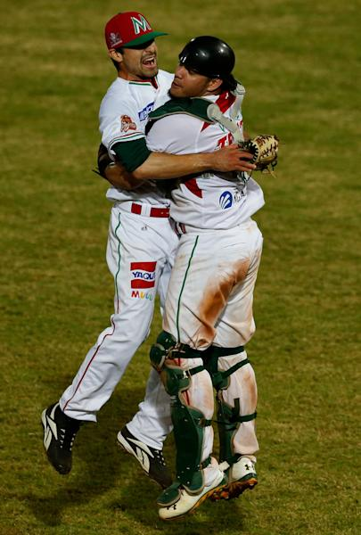 Mexico's pitcher Andres Avila, left, celebrates with his teammate Sebastian Valle after they winning the Caribbean Series baseball tournament in Porlamar, Venezuela, Saturday, Feb. 8, 2014. Mexico defeated Puerto Rico 7-1 in the final. (AP Photo/Fernando Llano)