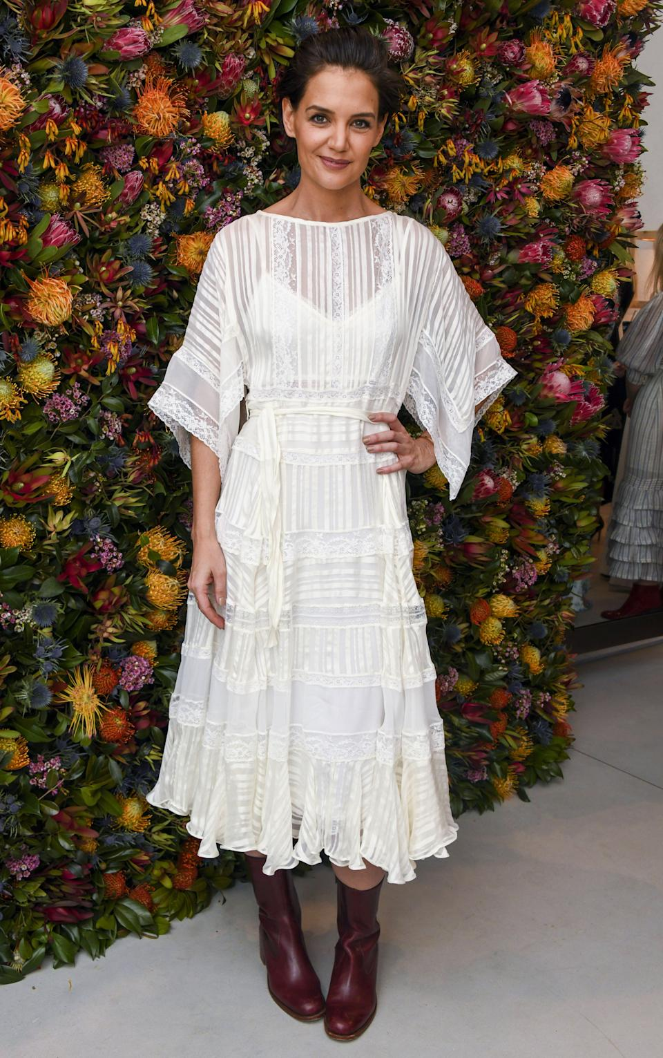 <p>The former 'Dawson's Creek' star arrived in a white midi dress with wide sleeves. <em>[Photo: Rex]</em> </p>