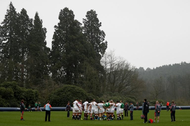 England's head coach Eddie Jones (4R) takes a team training session at Pennyhill Park in Bagshot, west of London on March 16, 2017