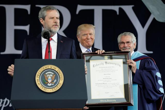 <p>U.S. President Donald Trump (C) is awarded a doctorate degree before delivering keynote address at Liberty University's commencement in Lynchburg, Virginia, May 13, 2017. (Photo: Yuri Gripas/Reuters) </p>