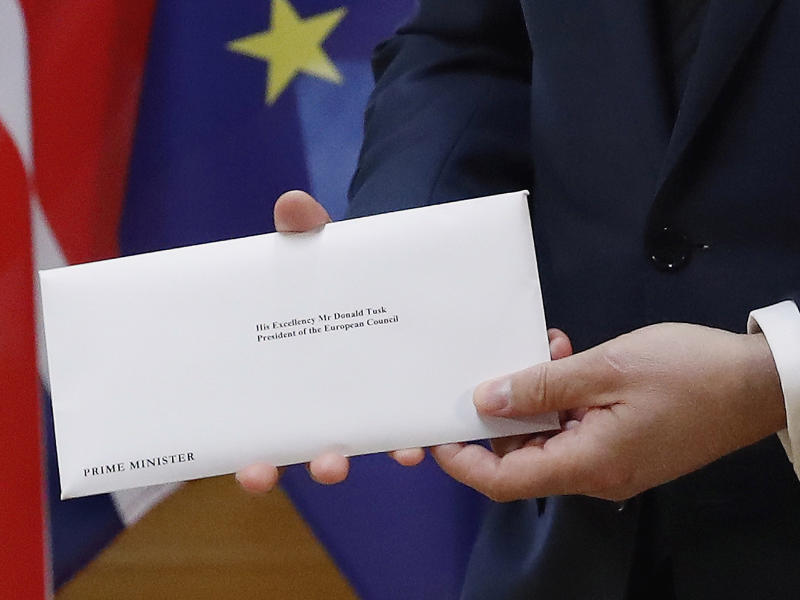 EU Council President Donald Tusk holds the official letter from Theresa May, beginning the withdrawal process from the EU: EPA