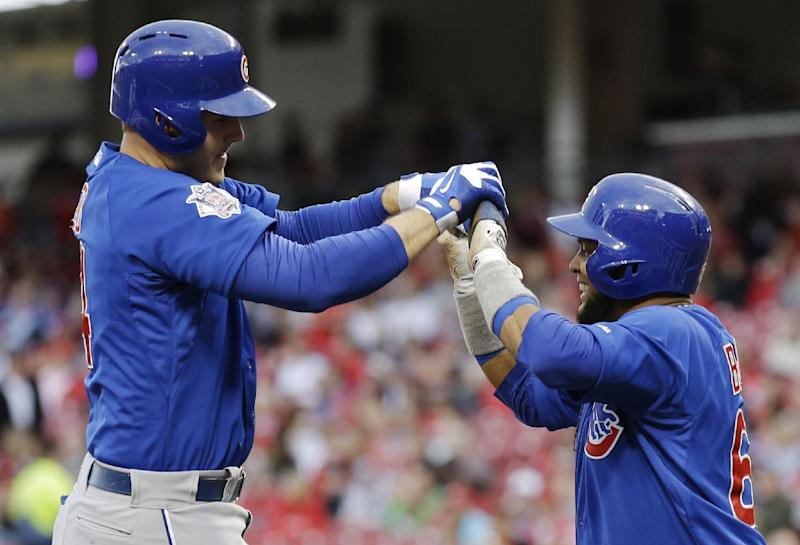 Chicago Cubs' Anthony Rizzo, left, is congratulated by Emilio Bonifacio after hitting a two-run home run off Cincinnati Reds starting pitcher Tony Cingrani in the first inning of a baseball game on Wednesday, April 30, 2014, in Cincinnati. (AP Photo)