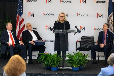 Moore CEO Gretchen Littlefield address audience during Richmond Print Group ribbon cutting ceremony.