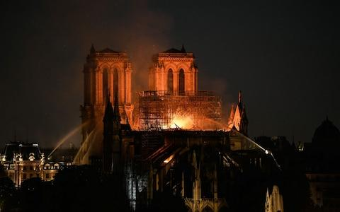 Britain stands ready to help efforts to rebuild Notre-Dame - Credit: BERTRAND GUAY/AFP
