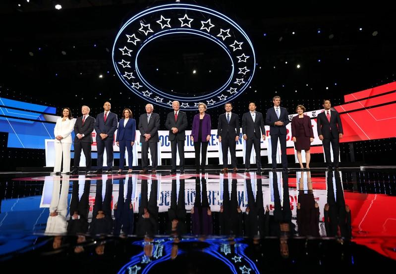 FILE PHOTO: Democratic presidential candidates pose together at the start of the fourth U.S. Democratic presidential candidates 2020 election debate at Otterbein University in Westerville, Ohio U.S.