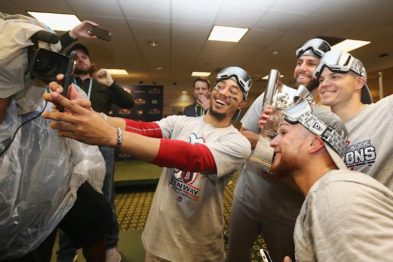 Boston slugger Mookie Betts celebrates the Red Sox win over the Houston Astros in the American League Championship Series (AFP Photo/ELSA)