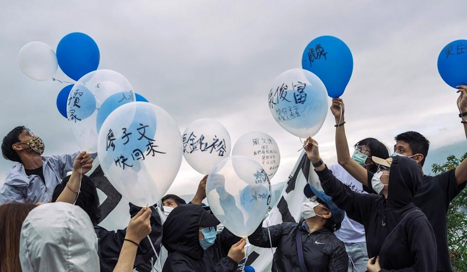 Activists and family members of 12 Hongkongers held on the mainland release balloons marked with the names of the detainees last month. Photo: Bloomberg