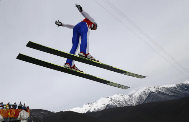 Norway's Haavard Klemetsen soars through the air during a men's nordic combined training session at the 2014 Winter Olympics, Sunday, Feb. 9, 2014, in Krasnaya Polyana, Russia. (AP Photo/Dmitry Lovetsky)