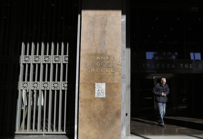 A man leaves the Bank of Greece headquarters in central Athens