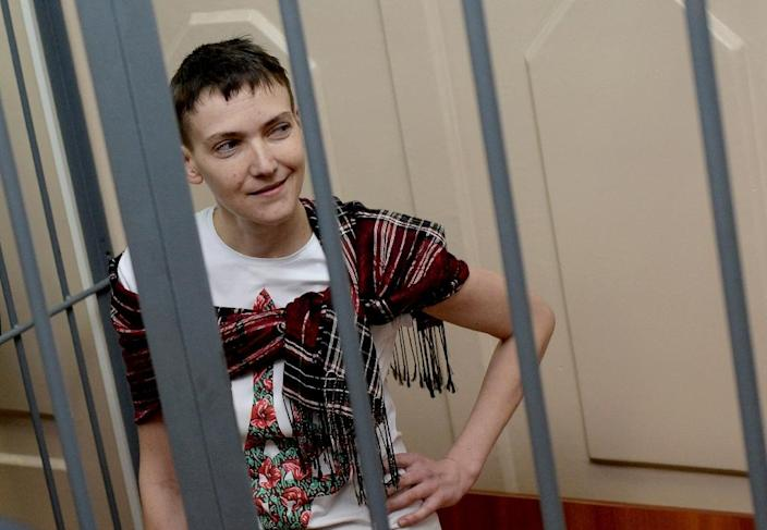 Ukrainian airforce officer Nadiya Savchenko reacts inside a defendants' cage as she attends a hearing at the Basmanny district court in Moscow on March 26, 2015 (AFP Photo/Vasily Maximov)