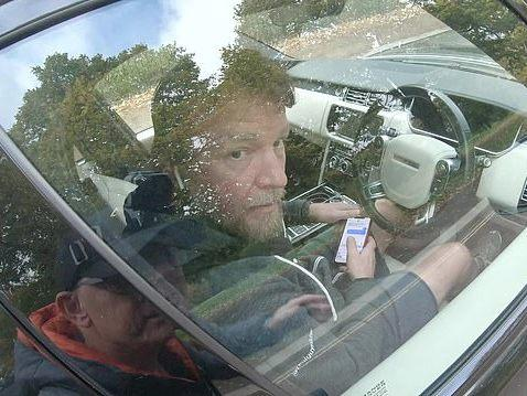 Guy Ritchie is caught on video texting while driving by YouTuber CyclingMikey: CyclingMikey/YouTube