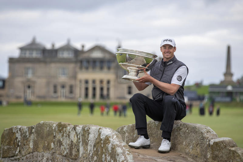 Victor Perez poses with the trophy following his win of the Links Championship at St Andrews in Scotland, Sunday Sept. 29, 2019. (Kenny Smith/PA via AP)