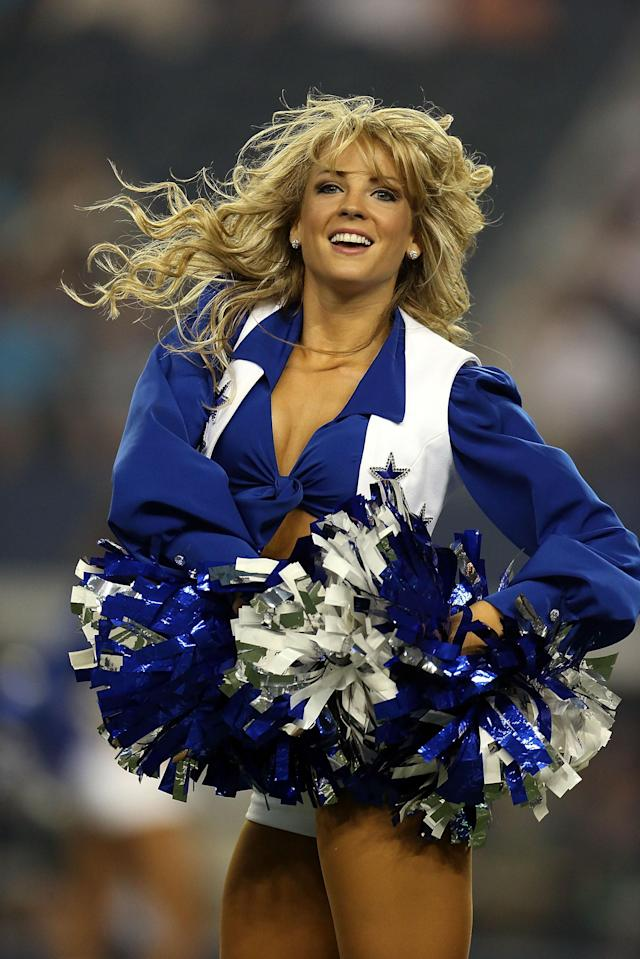 ARLINGTON, TX - AUGUST 25: A Dallas Cowboys Cheerleader performs at Cowboys Stadium on August 25, 2012 in Arlington, Texas. (Photo by Ronald Martinez/Getty Images)