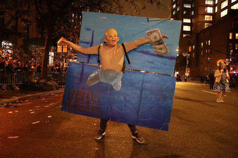 A man dressed as a Nirvana album cover from the 1990's marches in the Halloween Parade in New York City. (Photo: Gordon Donovan/Yahoo News)