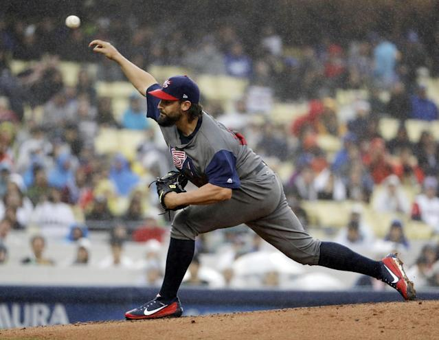 <p>United States' Tanner Roark throws during the first inning of a semifinal in the World Baseball Classic against Japan in Los Angeles, Tuesday, March 21, 2017. (AP Photo/Chris Carlson) </p>