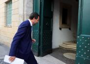 Leader of Italy's far-right League party Matteo Salvini enters the party's headquarters, in Rome