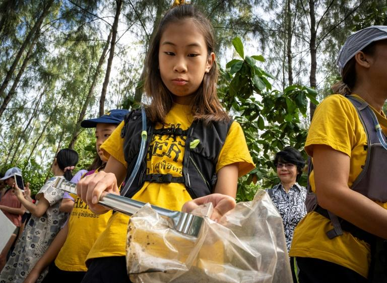 US-Thai youngster Lilly started campaigning at the age of eight after a seaside vacation in southern Thailand where she was horrified by a beach covered in rubbish (AFP Photo/Mladen ANTONOV)