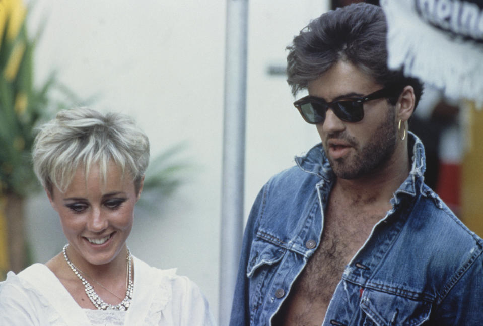 George Michael (1963 - 2016), of Wham!, pictured together with Shirlie Holliman backstage prior to performing at their farewell concert, entitled 'The Final' at Wembley Stadium in London on 28th June 1986. (Photo by Michael Putland/Getty Images)