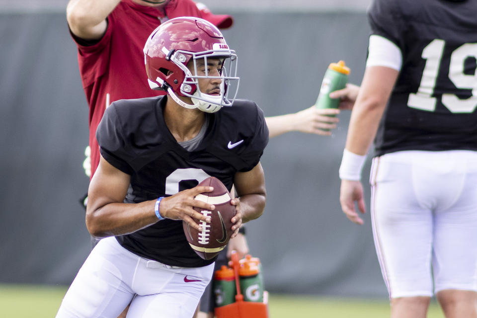 Alabama quarterback Bryce Young (9) rolls out on a passing drill during the NCAA college football team's practice Thursday, Aug. 12, 2021, in Tuscaloosa, Ala. (AP Photo/Vasha Hunt)
