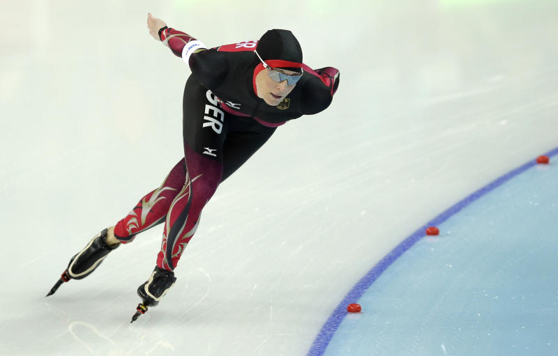 Claudia Pechstein of Germany competes in the women's 3,000-meter speedskating race at the Adler Arena Skating Center during the 2014 Winter Olympics, Sunday, Feb. 9, 2014, in Sochi, Russia. (AP Photo/Pavel Golovkin)