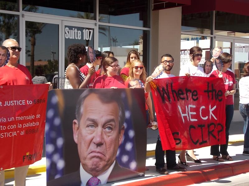 Demonstrators rally outside Republican Rep. Joe Heck's office in Las Vegas, June 4, 2014. (Photo: Progressive Leadership Alliance of Nevada, Astrid Silva/AP)