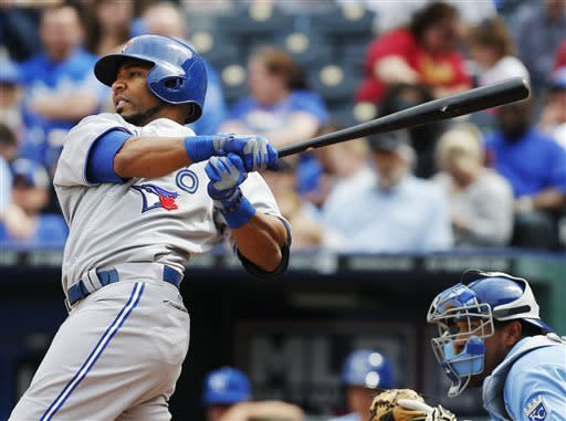 Toronto Blue Jays' Edwin Encarnacion, left, hits a solo home run during the sixth inning of a baseball game against the Kansas City Royals at Kauffman Stadium in Kansas City, Mo., Sunday, April 14, 2013. (AP Photo/Orlin Wagner)