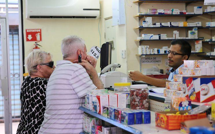 Two Americans are being helped at a pharmacy in Nogales, Mexico, in 2015. (Photo: Alicia Clark/Cronkite News)