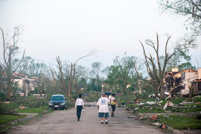 Residents of the West Brook neighborhood emerge from shelter to inspect the damage in their neighborhood after a suspected ef-4 tornado touched down early in the morning on May 28, 2019 in Trotwood, Ohio. (Photo: Matthew Hatcher/Getty Images)