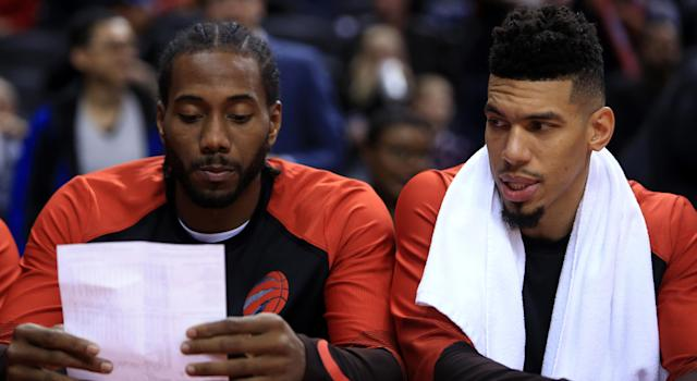 Kawhi Leonard and Danny Green are looking over some trick plays, probably. (Photo by Vaughn Ridley/Getty Images)