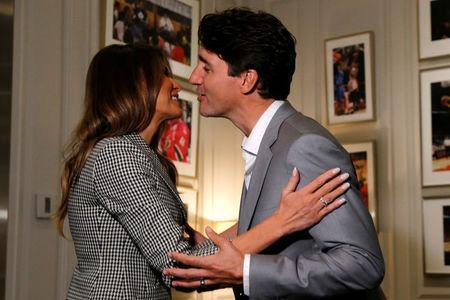 U.S. first lady Melania Trump greets Canada's Prime Minister Justin Trudeau as she arrives before the opening ceremony of the Invictus Games in Toronto, Canada September 23, 2017. REUTERS/Jonathan Ernst
