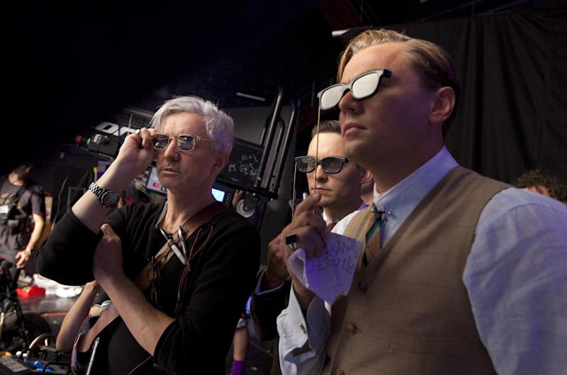 "This film publicity image released by Warner Bros. Pictures shows director Baz Luhrmann, left, with actors Tobey Maguire, and Leonardo DiCaprio in a scene from ""The Great Gatsby."" Luhrmann will open the 66th Cannes Film Festival on Wednesday, May 15, 2013, with the international premiere of ""The Great Gatsby.""  (AP Photo/Warner Bros. Pictures, Douglas Kirkland)"