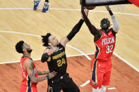 New Orleans Pelicans forward Wenyen Gabriel, right, and Memphis Grizzlies forward Dillon Brooks, center, reach for the ball as guard Nickeil Alexander-Walker, left, moves for position in the first half of an NBA basketball game Monday, May 10, 2021, in Memphis, Tenn. (AP Photo/Brandon Dill)