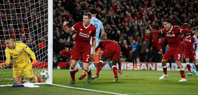 <p>Soccer Football – Champions League Quarter Final First Leg – Liverpool vs Manchester City – Anfield, Liverpool, Britain – April 4, 2018 Liverpool's James Milner and Roberto Firmino celebrate after Sadio Mane scored their third goal REUTERS/Andrew Yates </p>