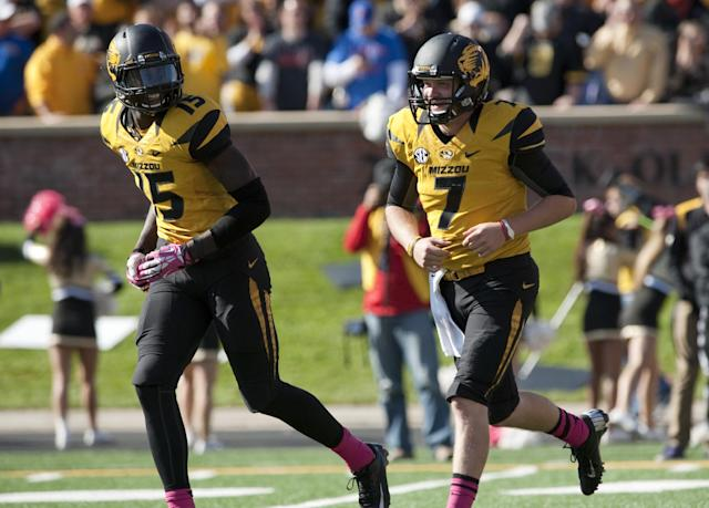 Missouri quarterback Maty Mauk, right, laughs with teammate Dorial Green-Beckham, left, after Mauk scored a touchdown during the fourth quarter of an NCAA college football game against Florida Saturday, Oct. 19, 2013, in Columbia, Mo. (AP Photo/L.G. Patterson)